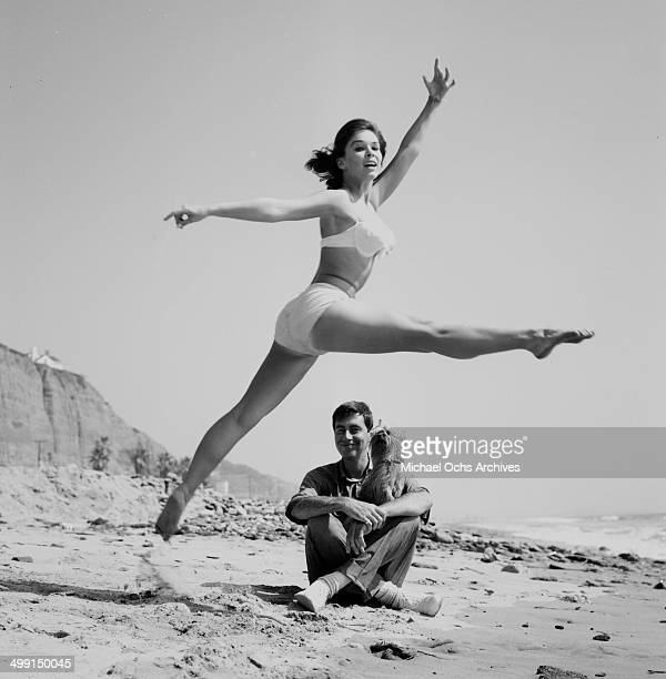 Actress Yvonne Craig poses with Jack Mullaney at the beach in Los Angeles California