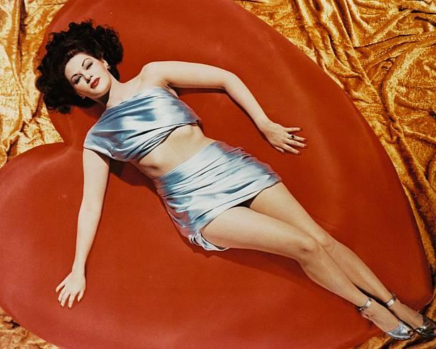 actress-yvonne-de-carlo-lying-on-a-giant