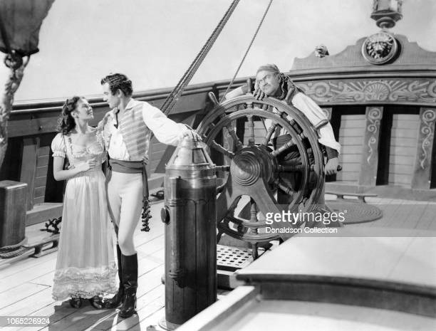 Actress Yvonne De Carlo Philip Friend and Jay C Flippen in a scene from the movie Buccaneer's Girl