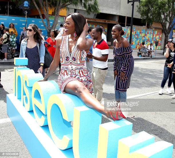 Actress Yvonne Orji Executive producer Prentice Penny and actress executive producer and star Issa Rae attend a block party celebrating HBO's new...