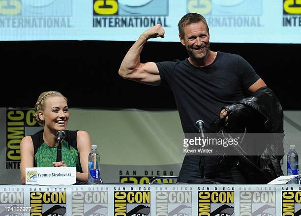 Actress Yvonne Strahovski and actor Aaron Eckhart speaks onstage at the Lionsgate preview featuring 'I Frankenstein' and 'The Hunger Games Catching...