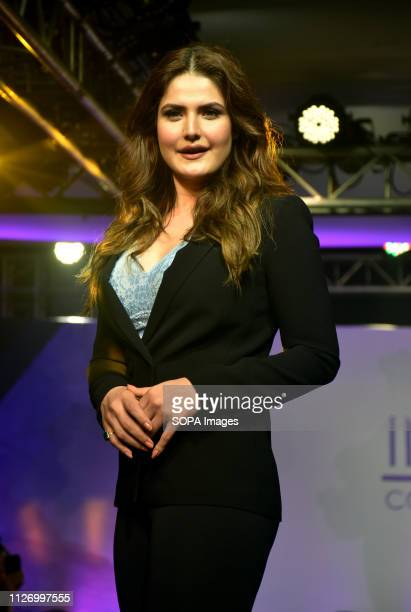 Actress Zarine Khan walks the ramp during the Parfait Lingerie Plus Size Fashion Show at hotel JW Marriott in Mumbai