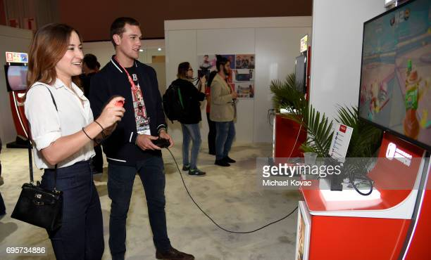 Actress Zelda Williams and Taylor John Smith visit the Nintendo booth at the 2017 E3 Gaming Convention at Los Angeles Convention Center on June 13...
