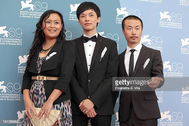 Actress Zhang Shu Min producer Yang Cheng and director Li Ruijun attend the 'Fly With The Crane' Photocall during the 69th Venice Film Festival at...