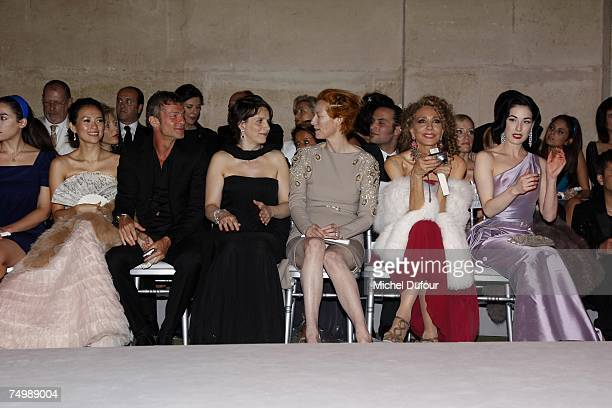 Actress Zhang Ziyi and boy friend actresses Juliette Binoche Tilda Swinton Marisa Berenson and burlesque performer and model Dita von Teese watch...