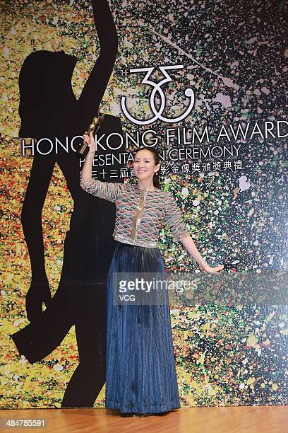 Actress Zhang Ziyi holds the trophy during the 33rd Hong Kong Film Awards red carpet on April 13 2014 in Hong Kong Hong Kong