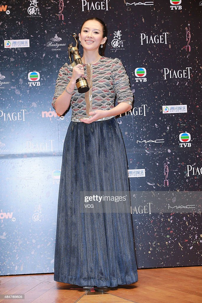 Actress Zhang Ziyi holds the trophy during the 33rd Hong Kong Film Awards red carpet on April 13, 2014 in Hong Kong, Hong Kong.