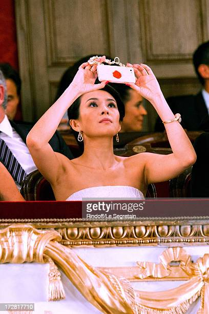 Actress Zhang Ziyi on her phone during Le Grand Bal De La Comedie Francaise held at La Comedie Francaise on July 4 2013 in Paris France