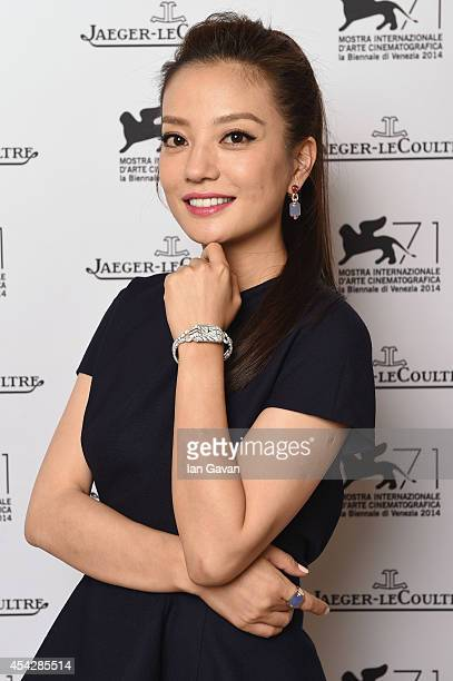 Actress Zhao Wei of 'Qin'ai de' wearing the JaegerLeCoultre Reverso Cordonnet watch poses for a portrait for JaegerLeCoultre in their festival lounge...