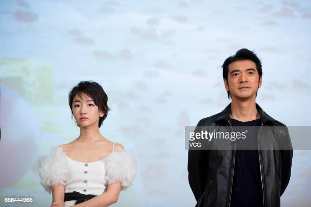 Actress Zhou Dongyu and actor Takeshi Kaneshiro attend the world premiere of film 'This is not what I Expected' during Beijing Film Panorama of 2017...
