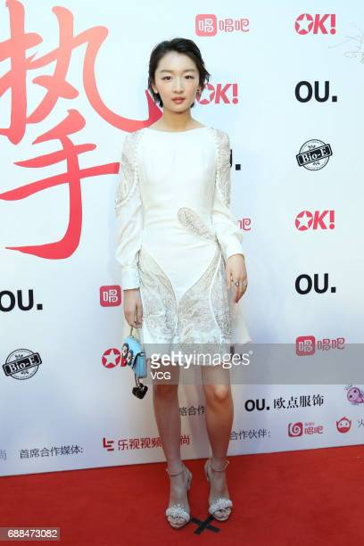 Actress Zhou Dongyu arrives at the red carpet of the 5th anniversary award ceremony of a singing app Changba at Beijing Tiaoqiao Performing Arts...