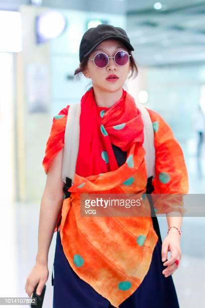 Actress Zhou Xun arrives at Beijing Capital International Airport on August 5 2018 in Beijing China