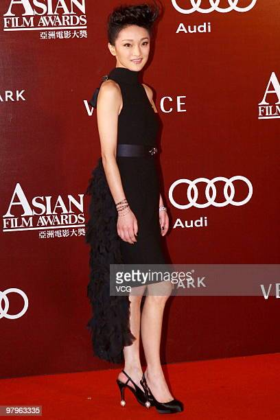 Actress Zhou Xun poses on the red carpet for the 4th Asian Film Awards ceremony at the Convention and Exhibition Centre on March 22, 2010 in Hong...