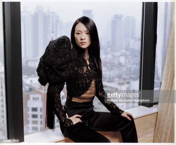 Actress Ziyi Zhang in a portrait session for Madame Figaro in Shanghai China in 2006 Ms Zhang wears an asymmetrical jadeembroidered lace bolero with...