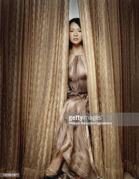 Actress Ziyi Zhang in a portrait session for Madame Figaro in Shanghai China in 2006 Ms Zhang wears a long dress in undulating crystalembroidered...