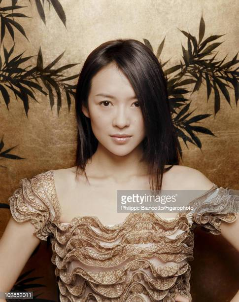 Actress Ziyi Zhang in a portrait session for Madame Figaro in Shanghai China in 2006 Ms Zhang wears a backless silk dress by Giorgio Armani with...