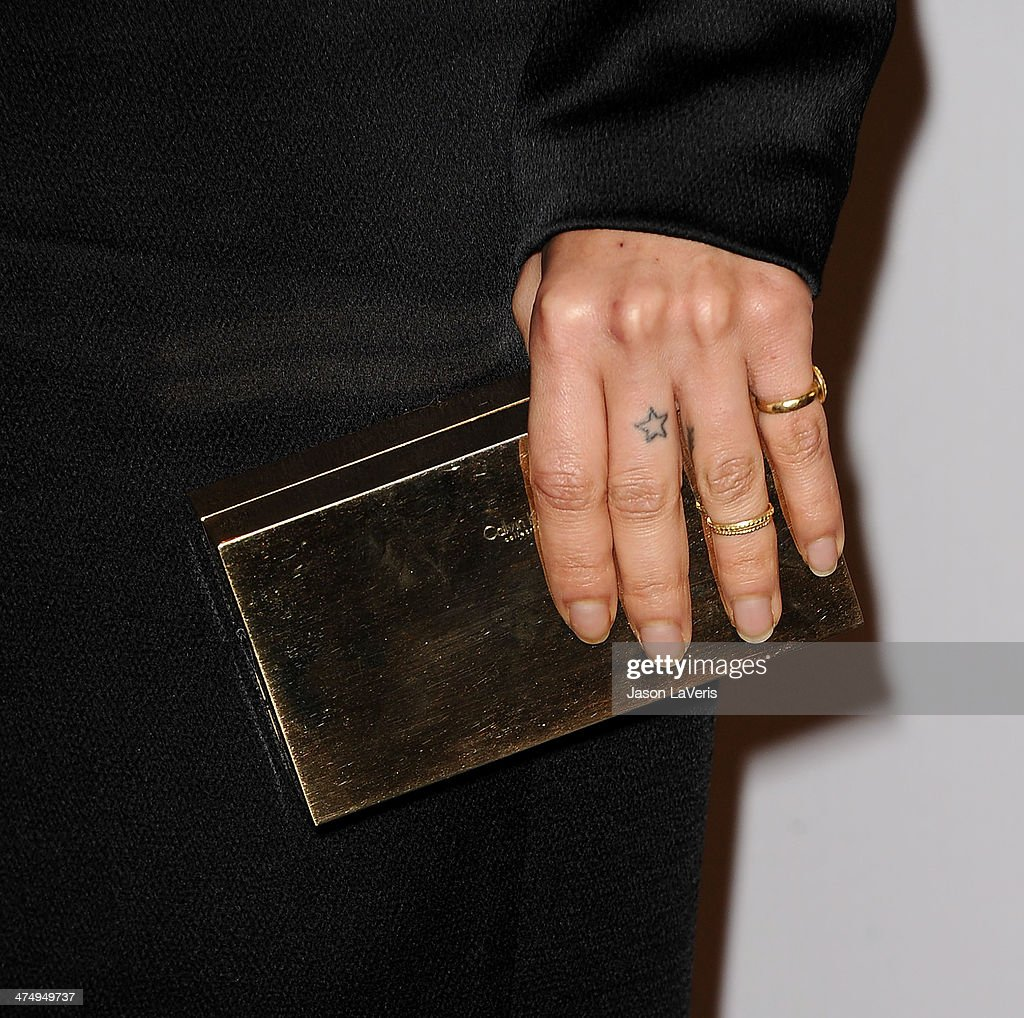 Actress Zoe Kravitz (handbag and jewelry detail) attends the Vanity Fair Campaign Young Hollywood party at No Vacancy on February 25, 2014 in Los Angeles, California.