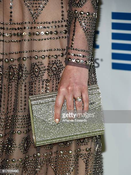 Actress Zoe ListerJones clutch detail arrives at the 26th Annual EMA Awards at Warner Bros Studios on October 22 2016 in Burbank California