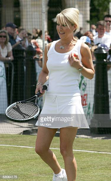 Actress Zoe Lucker plays tennis at the Ariel Celebrity Tennis Match held in Trafalgar Square on June 13 2005 in London England