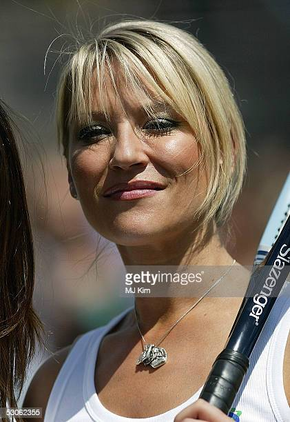 Actress Zoe Lucker poses for photographers at the Ariel Celebrity Tennis Match held in Trafalgar Square on June 13 2005 in London England