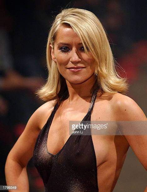 Actress Zoe Lucker walks the runway during the show for the Scott Henshall Spring 2003 Collection at London Fashion Week February 15 2003 in London...