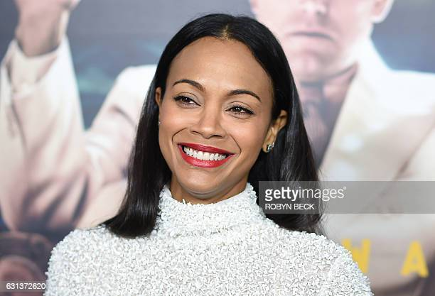 Actress Zoe Salanda arrives for the world premiere of Warner Bros Live By Night January 9 2017 at the TCL Chinese Theater in Hollywood California /...