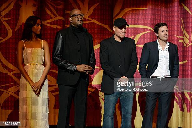 Actress Zoe Saldana actor Forest Whitaker actor Woody Harrelson and actor Casey Affleck attend the screening of Out of the Furnace during AFI FEST...