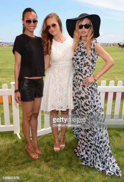 Actress Zoe Saldana, actress Minka Kelly and stylist Rachel Zoe pose at the VIP Marquee during the fifth Annual Veuve Clicquot Polo Classic on June...