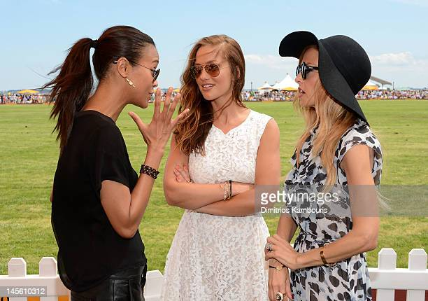 Actress Zoe Saldana, actress Minka Kelly and stylist Rachel Zoe talk at the VIP Marquee during the fifth Annual Veuve Clicquot Polo Classic on June...