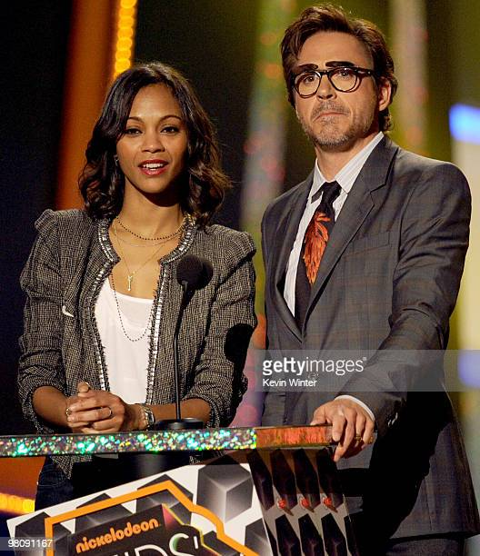 Actress Zoe Saldana and actor Robert Downey Jr present the Favorite Movie award onstage at Nickelodeon's 23rd Annual Kids' Choice Awards held at...