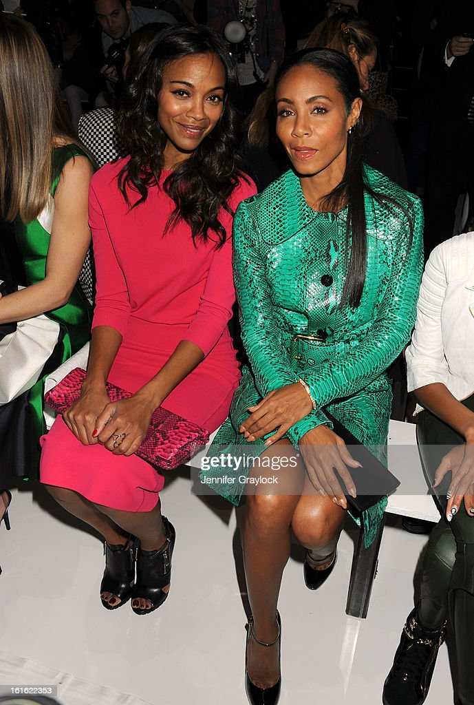 Actress Zoe Saldana and Actress Jada Pinkett Smith front row during the Michael Kors Fall 2013 Mercedes-Benz Fashion Show at The Theater at Lincoln Center on February 13, 2013 in New York City.