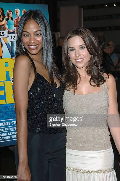 Actress Zoe Saldana and actress Lacey Chabert attend the world premiere of Dirty Deeds at the Directors Guild of America on August 23 2005 in Los...