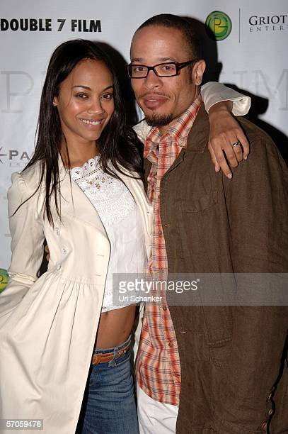 Actress Zoe Saldana and director Pete Chatmon pose at the party for the film 'Premium' at the Shore Club on March 11 2006 in Miami Beach Florida