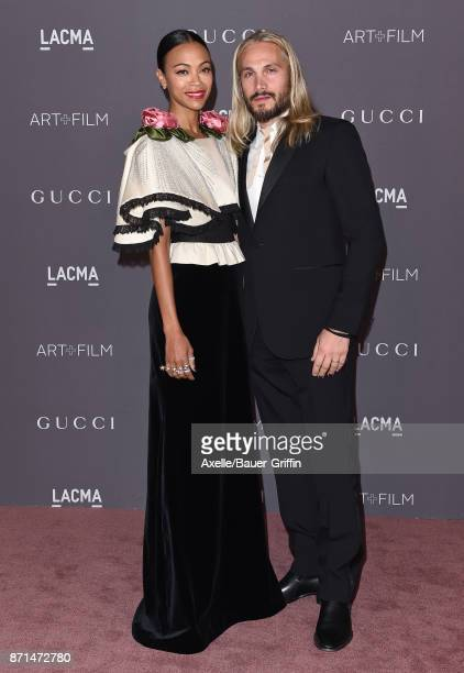 Actress Zoe Saldana and husband Marco Perego arrive at the 2017 LACMA Art Film Gala at LACMA on November 4 2017 in Los Angeles California