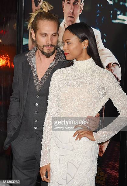 Actress Zoe Saldana and husband Marco Perego arrive at the Premiere Of Warner Bros Pictures' 'Live By Night' at TCL Chinese Theatre on January 9 2017...
