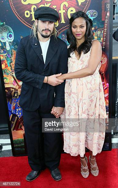 """Actress Zoe Saldana and husband Marco Perego attend the premiere of Twentieth Century Fox and Reel FX Animation Studios' """"The Book of Life"""" at Regal..."""