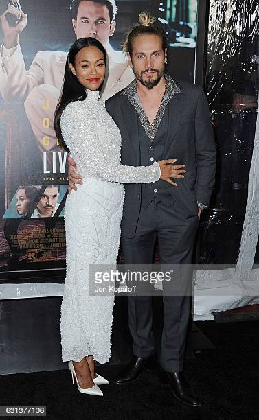 Actress Zoe Saldana and Marco Perego arrive at the Premiere of Live By Night at TCL Chinese Theatre on January 9 2017 in Hollywood California