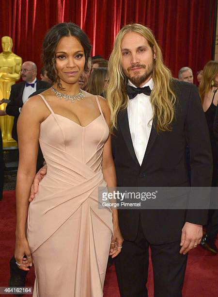 Actress Zoe Saldana and Marco Perego attend the 87th Annual Academy Awards at Hollywood Highland Center on February 22 2015 in Hollywood California