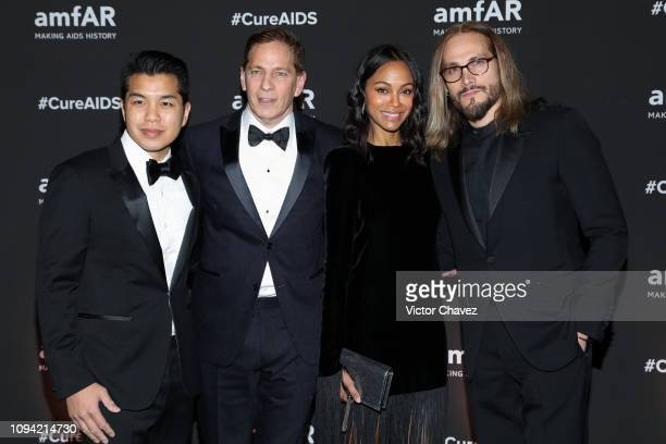 Actress Zoe Saldana and Marco Perego pose during the red carpet of the amfAR gala dinner at the house of collector and museum patron Eugenio López on...