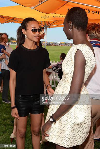 Actress Zoe Saldana and model Alek Wek at the VIP Marquee during the fifth Annual Veuve Clicquot Polo Classic on June 2, 2012 in Jersey City.