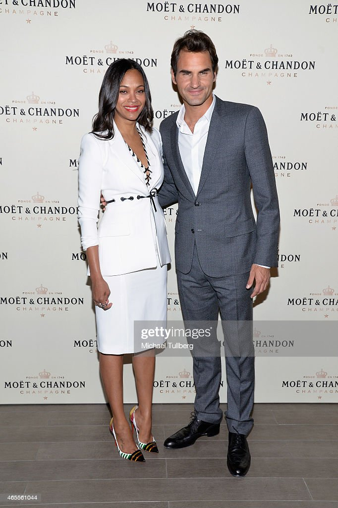Actress Zoe Saldana And Tennis Player Roger Federer Attend The Moet Chandon Toast To Honor