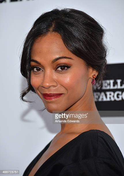 Actress Zoe Saldana arrives at amfAR The Foundation for AIDS 4th Annual Inspiration Gala at Milk Studios on December 12 2013 in Hollywood California