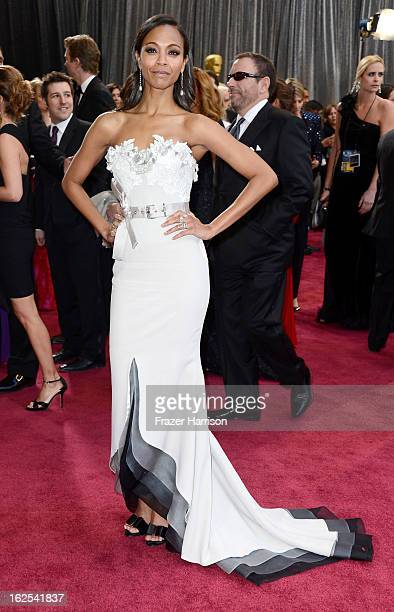Actress Zoe Saldana arrives at the Oscars at Hollywood Highland Center on February 24 2013 in Hollywood California