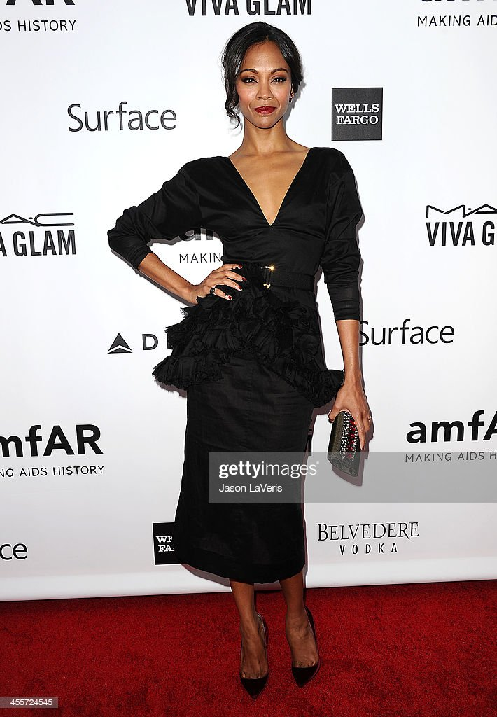 Actress Zoe Saldana attends the amfAR Inspiration Gala at Milk Studios on December 12, 2013 in Hollywood, California.