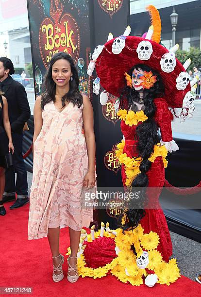 """Actress Zoe Saldana attends the premiere of Twentieth Century Fox and Reel FX Animation Studios' """"The Book of Life"""" at Regal Cinemas L.A. Live on..."""