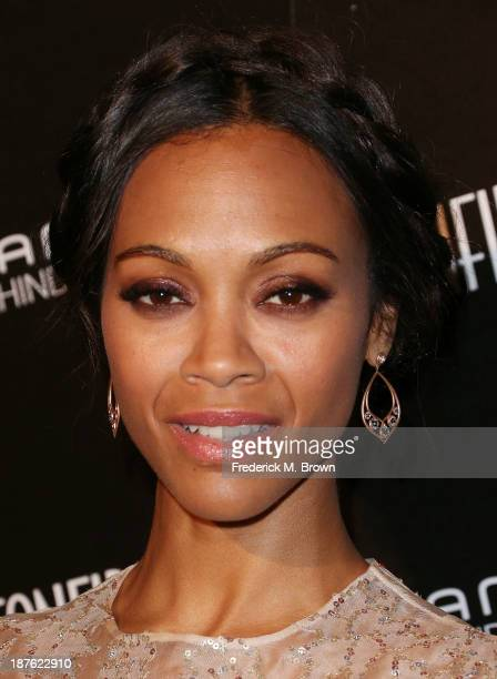 Actress Zoe Saldana attends the Seventh Annual Hamilton Behind the Camera Awards at The Wilshire Ebell Theatre on November 10 2013 in Los Angeles...