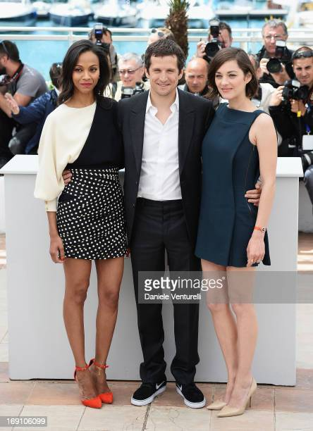 Actress Zoe Saldana director and actor Guillaume Canet and actress Marion Cotillard attend the photocall for 'Blood Ties' during the 66th Annual...