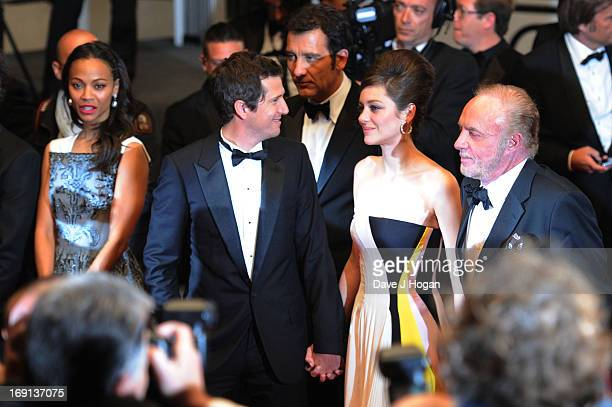 Actress Zoe Saldana director Guillaume Canet and actors Marion Cotillard and James Caan depart the 'Blood Ties' Premiere during the 66th Annual...