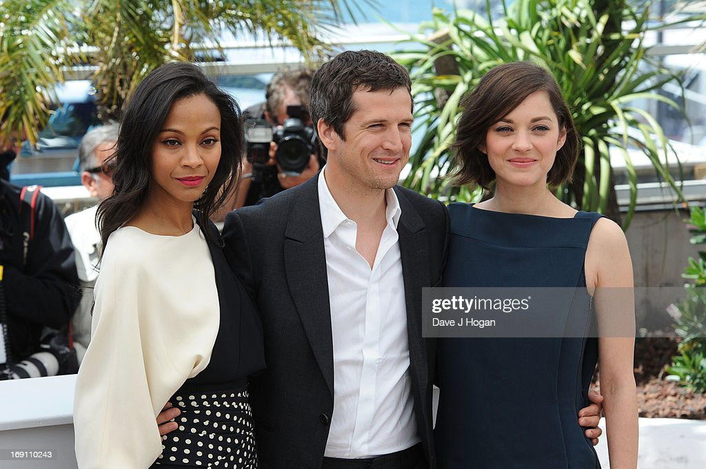 Actress Zoe Saldana, director Guillaume Canet and actress Marion Cotillard attends the photocall for 'Blood Ties' at The 66th Annual Cannes Film Festival on May 20, 2013 in Cannes, France.