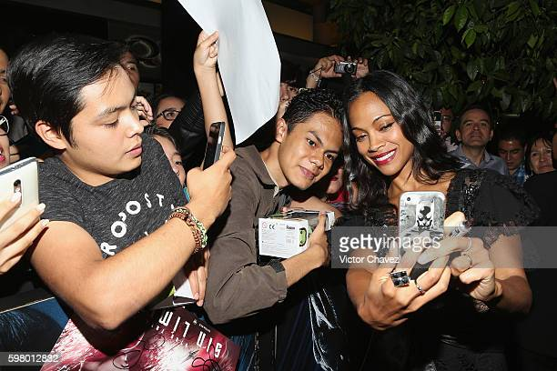 Actress Zoe Saldana signs autographs and takes selfies with fans during the promotional tour of the Paramount Pictures title 'Star Trek Beyond' at...